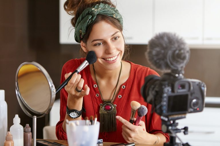 Modern technology, internet, blogging, e-commerce and marketing concept. Attractive popular female v